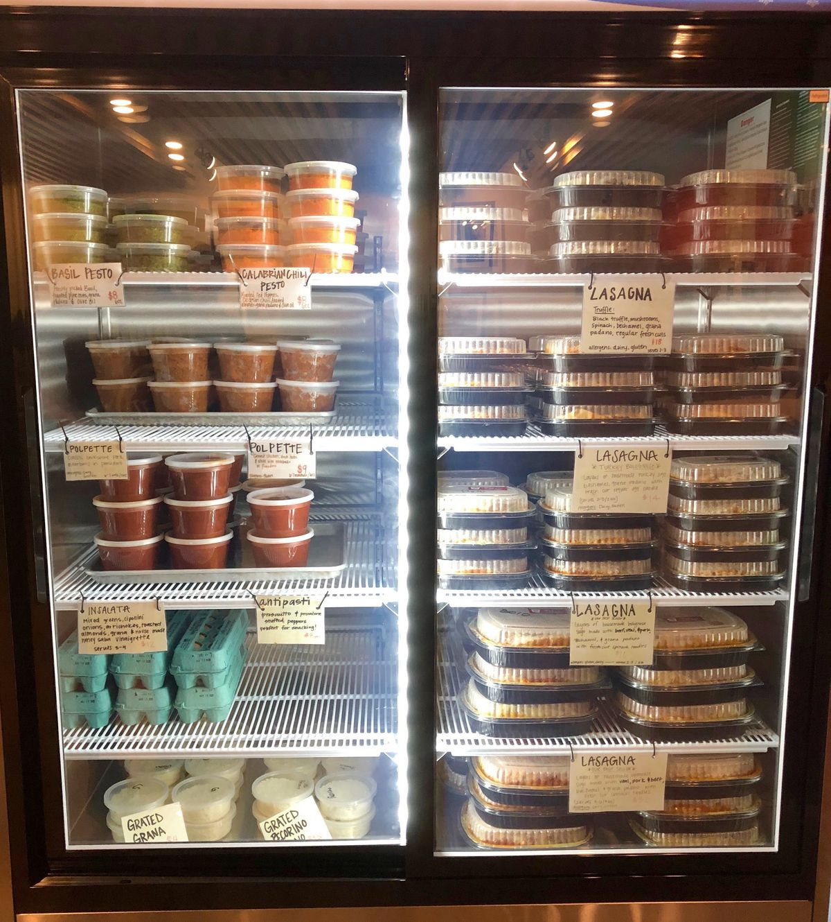 The cold case filled with pastas, sauces, eggs at Forza Storico open-air market at Westside Provisions