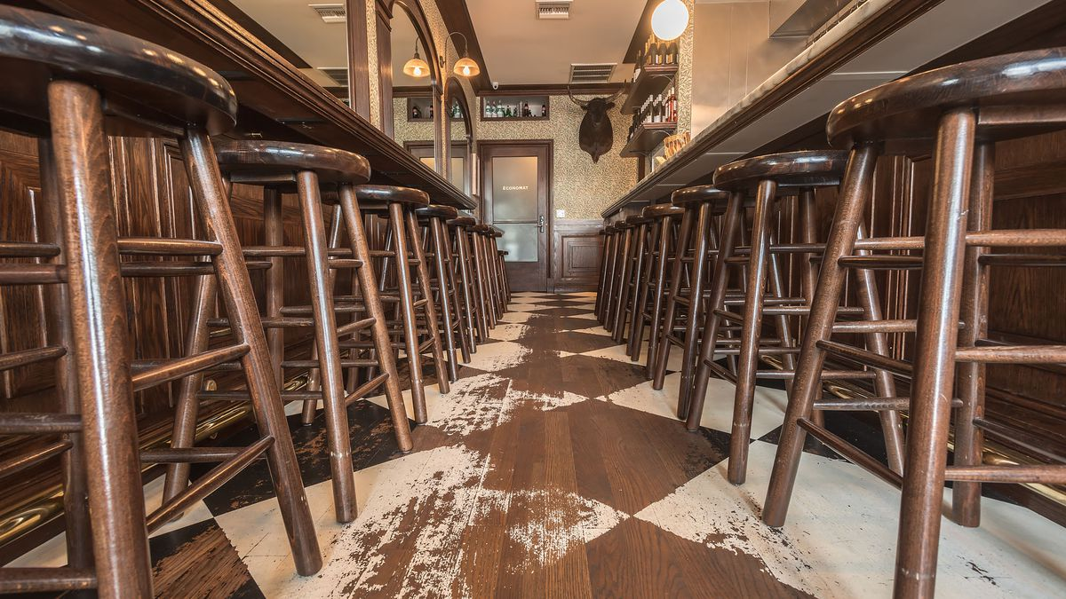 Two lines of barstools at Petit Trois, in Los Angeles.