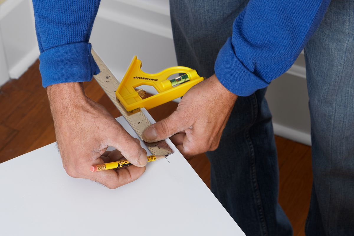 Mark Door Using Combination Square To Prep For Concealed Cabinet Hinges