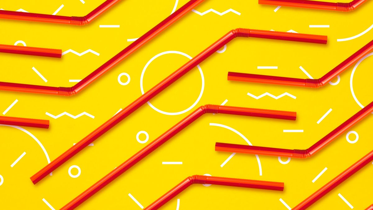 plastic drinking straws on a yellow background.