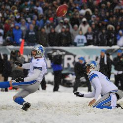 David Akers of the Lions has an extra-point attempt blocked