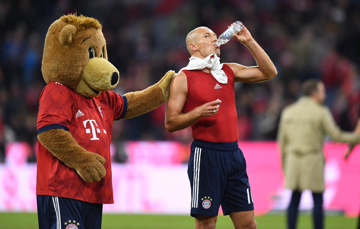 The Bayern Munich's mascot reacts with Bayern Munich's Dutch midfielder Arjen Robben after the German first division Bundesliga match between FC Bayern Munich and FC Augsburg in the stadium in Munich, southern Germany, on September 25, 2018.