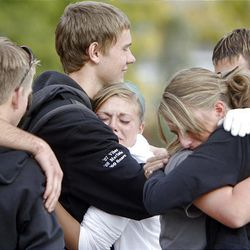 Members of the American Fork Marching Band comfort each other after practice for an upcoming competition and for the funeral of American Fork High band instructor Heather Christensen, who was killed in a bus accident on their way back from a band competition in Idaho over the weekend.