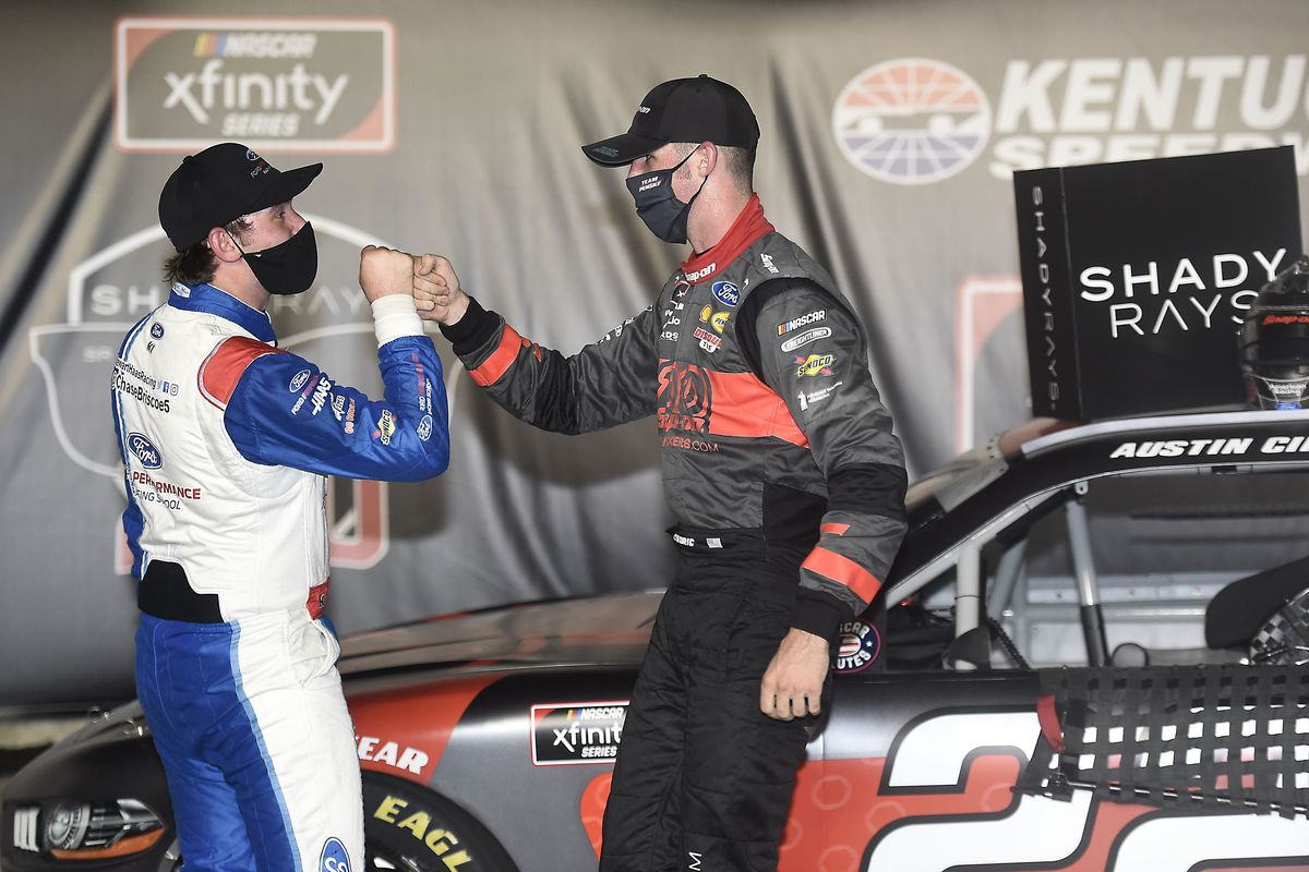 Austin Cindric, driver of the #22 Snap-On Ford, (R) celebrates in Victory Lane with Chase Briscoe, driver of the #98 Ford Performance Racing School Ford, after winning the NASCAR Xfinity Series Shady Rays 200 at Kentucky Speedway on July 09, 2020 in Sparta, Kentucky.