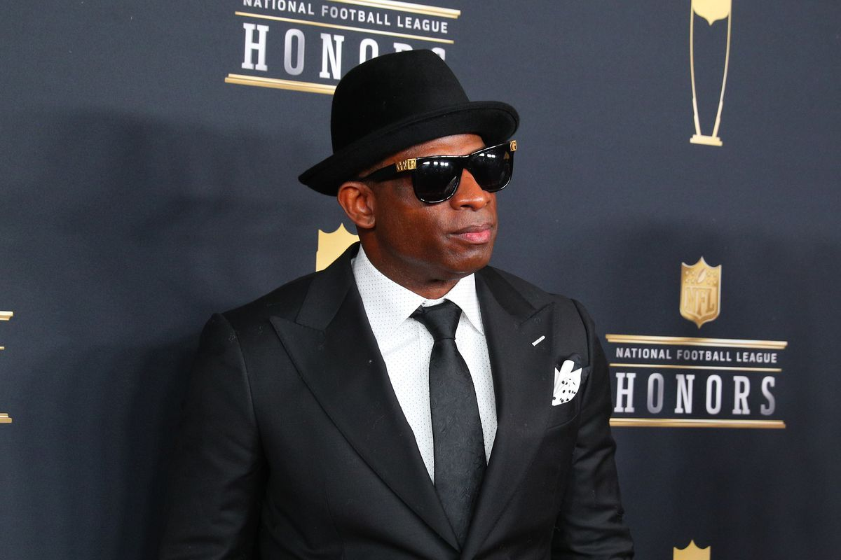Deion Sanders poses for photographs on the Red Carpet at NFL Honors during Super Bowl LII week on February 3, 2018, at Northrop at the University of Minnesota in Minneapolis, MN.