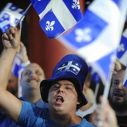 Parti Quebecois supporters cheer as election results are announced in Montreal, Tuesday, Sept. 4, 2012. The separatist party won power in the French-speaking province of Quebec on Tuesday night, but another referendum to break away from Canada isn't expected any time soon after the Parti Quebecois failed to win a majority of legislative seats.