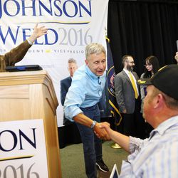 Libertarian presidential candidate Gov. Gary Johnson, right, and running mate Gov. Bill Weld wave to and greet supporters at the Student Union at the University of Utah in Salt Lake City on Saturday, Aug. 6, 2016.
