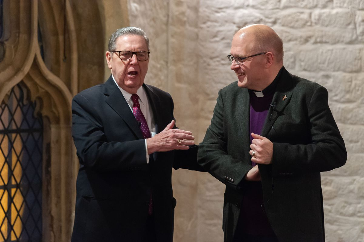 Elder Jeffrey R. Holland shares a light moment with the Rev. Dr. Andrew Teal during a public conversation.