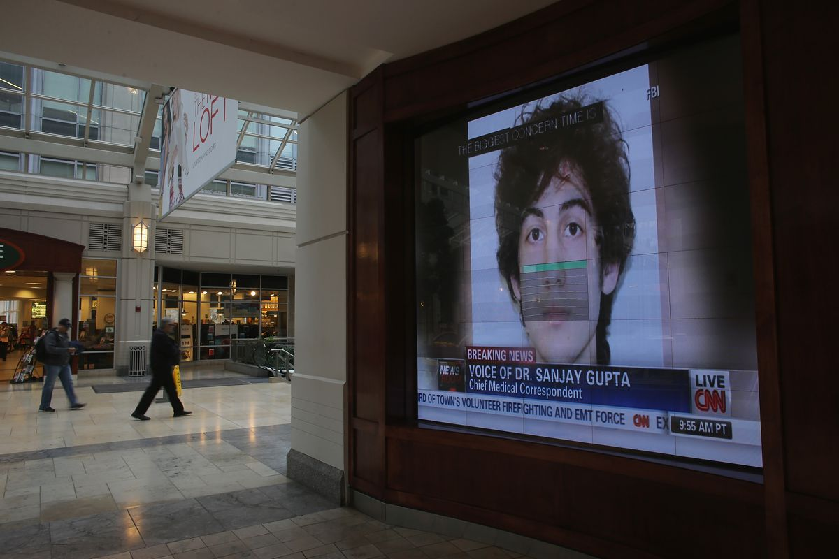A TV near the site of the Boston Marathon bombing displays Dzhokhar Tsarnaev's picture.