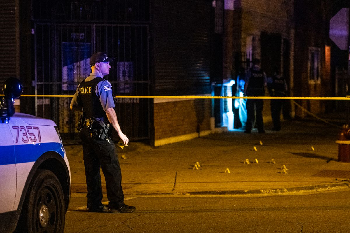 Police investigate the scene of a shooting