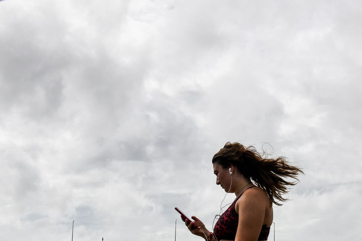 A woman holding a mobile phone.