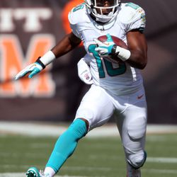 Sep 8, 2013; Cleveland, OH, USA; Miami Dolphins wide receiver Brandon Gibson (10) runs after a pass reception against the Cleveland Browns during the fourth quarter at FirstEnergy Field.