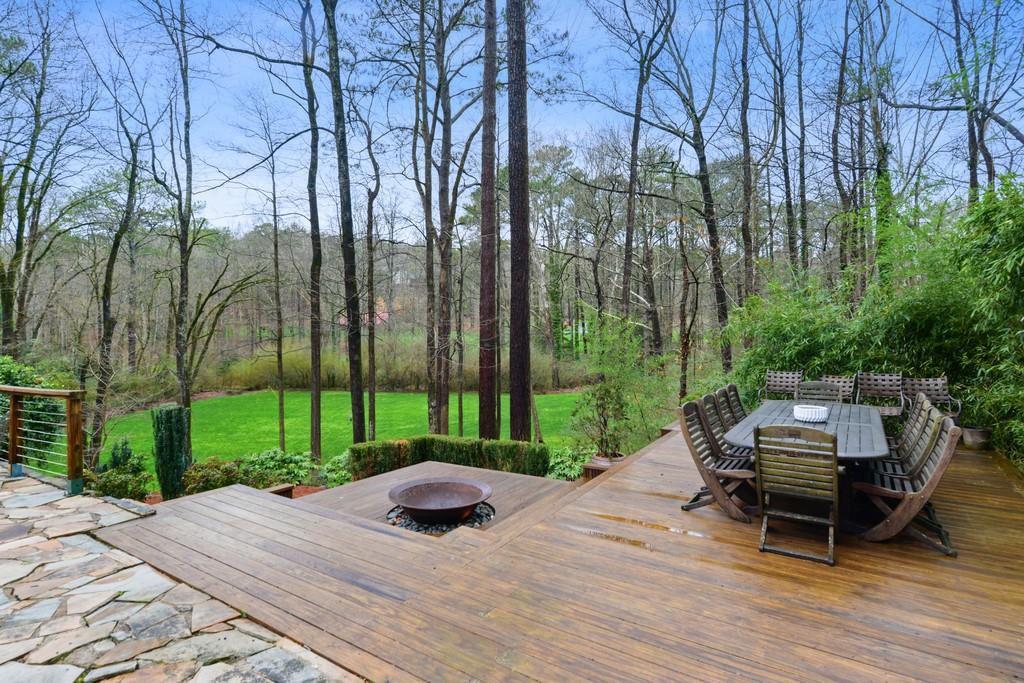 A big deck overlooking a huge green space.