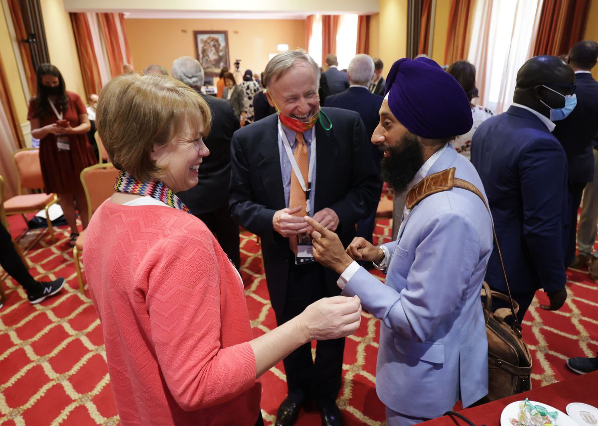 Sister Sharon Eubank, first counselor in The Church of Jesus Christ of Latter-day Saints' Relief Society general presidency, left, chats with David Pollei, of the G20Interfaith Forum Advisory Council, and Khushwant Singh.