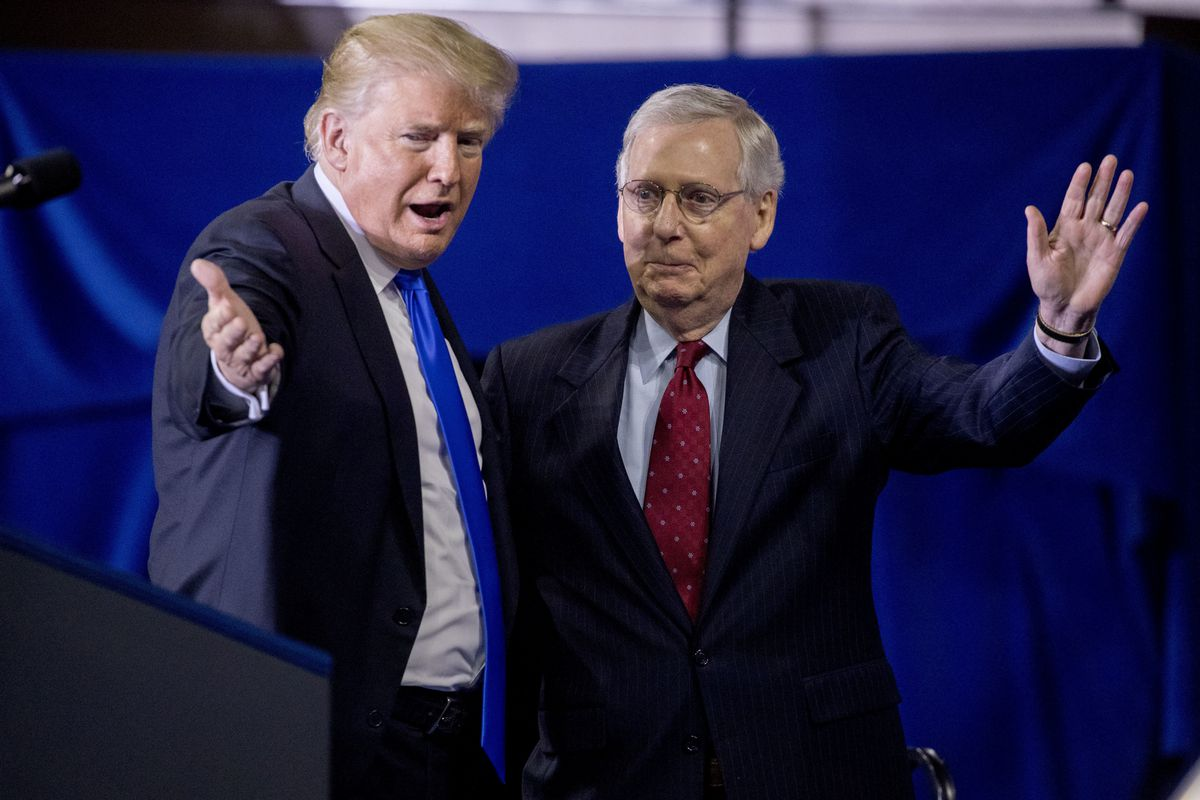 President Donald Trump, left, invites Senate Majority Leader Mitch McConnell, of Ky., right, onstage as he speaks at a rally at Alumni Coliseum in Richmond, Ky., Saturday, Oct. 13, 2018.