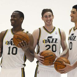The Jazz's Alec Burks, left, Gordon Hayward, center, and Enes Kanter joke around in between photos during media day at the Zions Bank Basketball Center on Sept. 30.