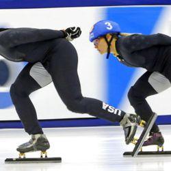 Maame Biney (1) and Jessica Kooreman (3) compete in the women's 1000-meters during the U.S.Olympic short track speedskating trials Sunday, Dec. 17, 2017, in Kearns, Utah. (AP Photo/Rick Bowmer)