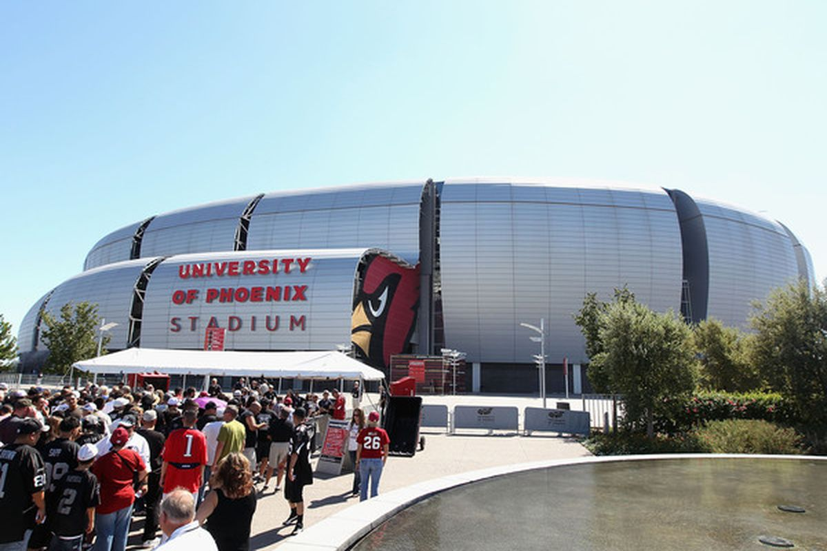 GLENDALE AZ - SEPTEMBER 26:  Fans of the Oakland Raiders and the Arizona Cardinals arrive to the NFL game at the University of Phoenix Stadium on September 26 2010 in Glendale Arizona.  (Photo by Christian Petersen/Getty Images)