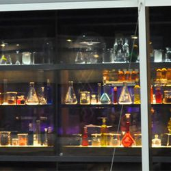 A wall of liquids and elixirs to evoke the alchemical laboratory theme.