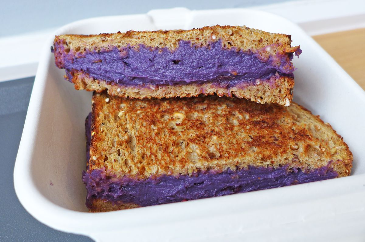 Yup, that's a purple vegan sandwich filled with pureed sweet potato.