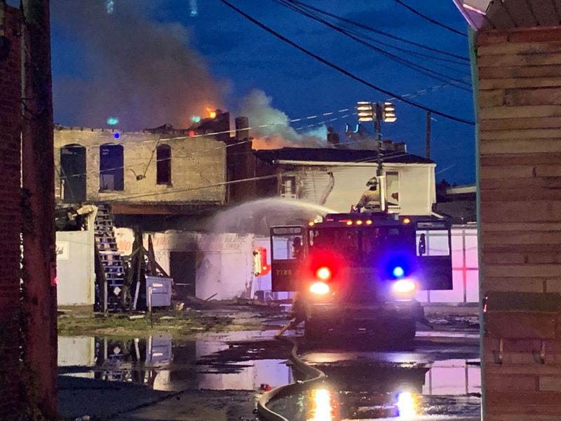 Kenosha firefighters worked early Tuesday to put out fires started during a second night of civil unrest after a Black man was wounded by police.