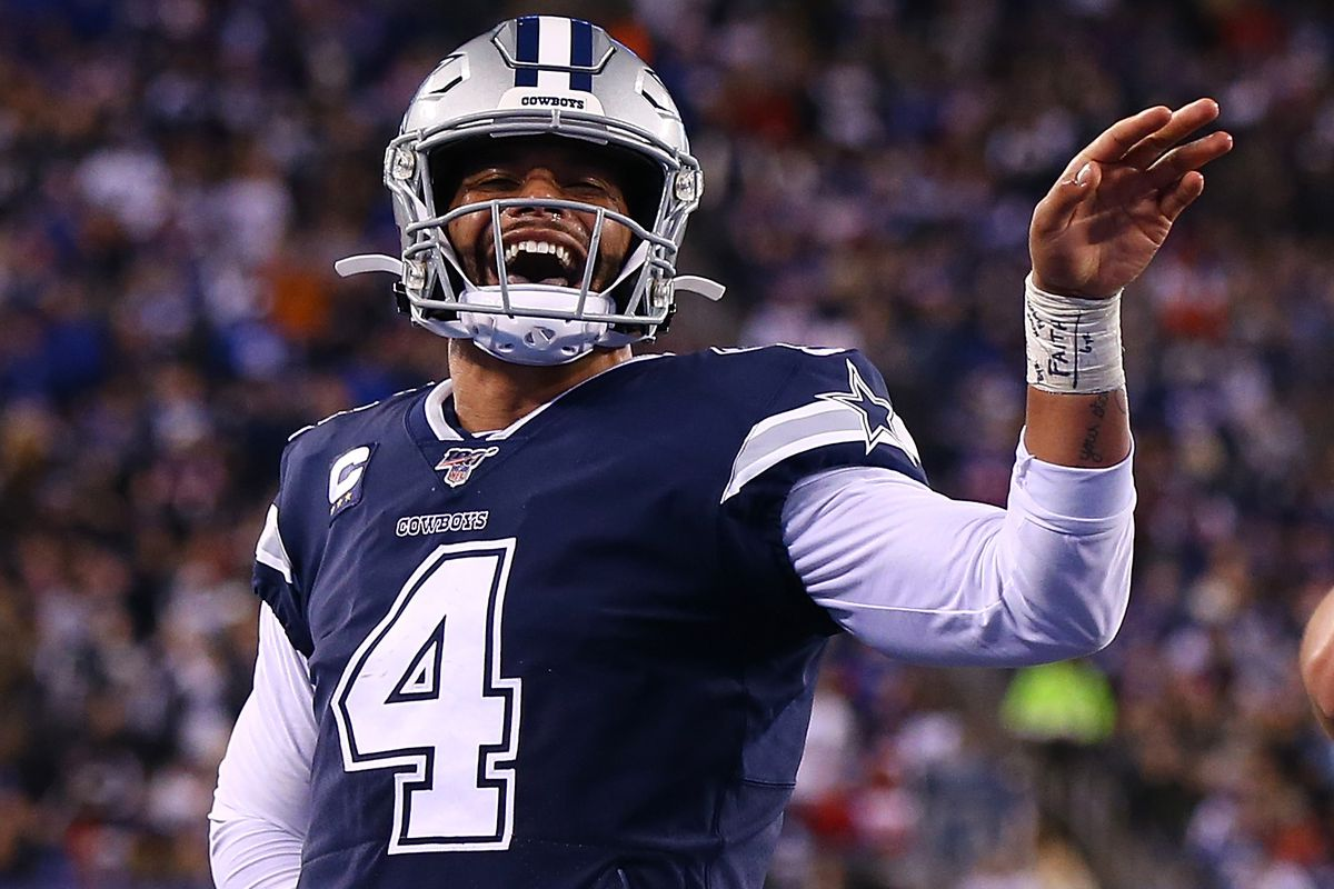 Dak Prescott #4 of the Dallas Cowboys celebrates a fourth quarter touchdown pass against the New York Giants at MetLife Stadium on November 04, 2019 in East Rutherford, New Jersey.Dallas Cowboys defeated New York Giants 37-18.