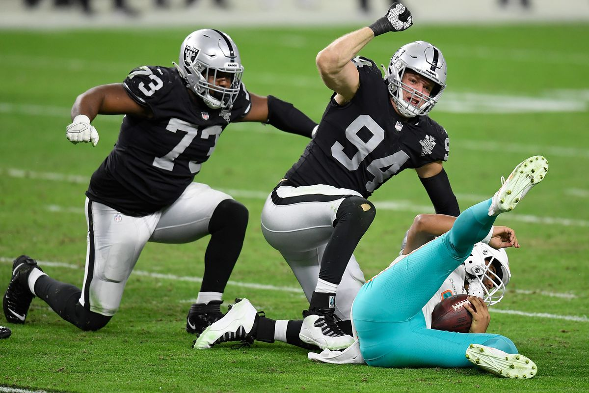 Carl Nassib #94 of the Las Vegas Raiders reacts to a sack of Tua Tagovailoa #1 of the Miami Dolphins during the second half of a game at Allegiant Stadium on December 26, 2020 in Las Vegas, Nevada.