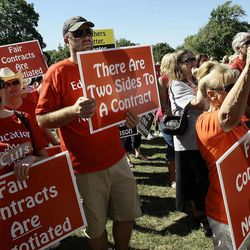 """Teachers from Ogden City School District, their families and others from surrounding districts, protest during a rally in Ogden Thursday, July 14, 2011, against the """"take it or leave it"""" contract issued to Ogden teachers several weeks ago."""