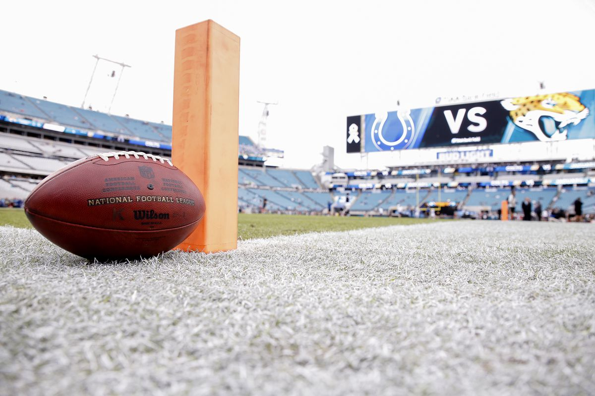 """A general view from the endzone of an Official Wilson """"Duke"""" football and a pylon on the field before the Jacksonville Jaguars host the Indianapolis Colts at TIAA Bank Field on December 2, 2018 in Jacksonville, Florida."""