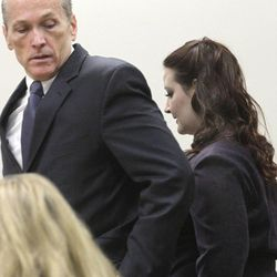 Gypsy Willis, who carried on an affair with Martin MacNeill, passes by him on her way to the witness stand to testifify in his murder trial in 4th District Court in Provo Thursday Nov. 7, 2013.