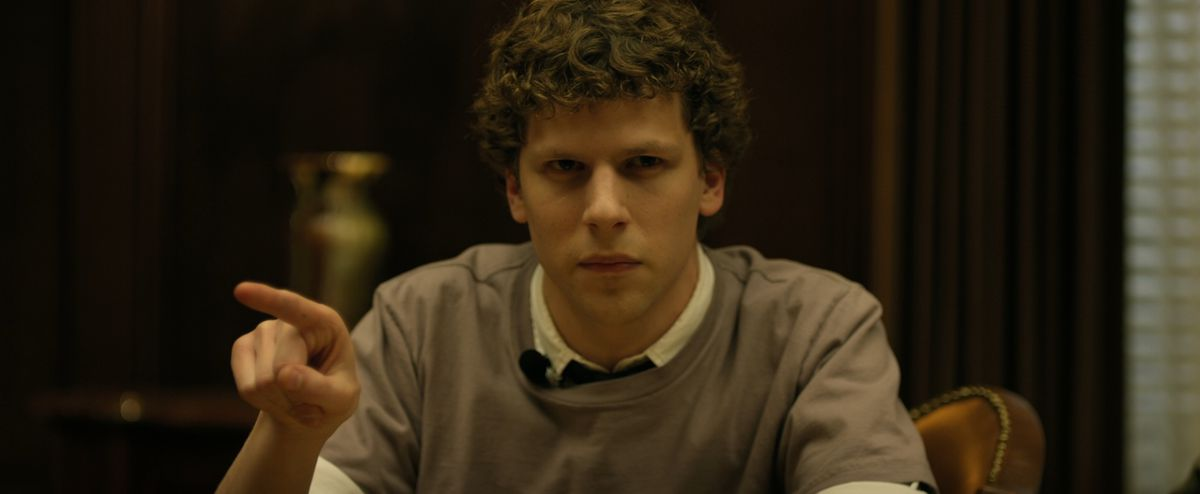 jesse eisenberg as the Zuckerberg brand points and frowned at the table during litigation on the social network