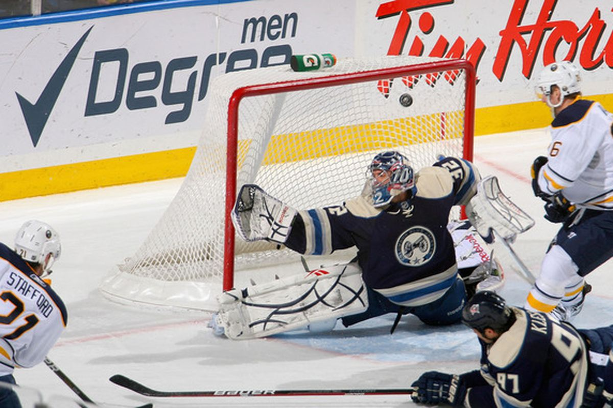BUFFALO NY - DECEMBER 03: Drew Stafford #21 of the Buffalo Sabres scores Buffalo's third goal against Mathieu Garon #32 of the Columbus Blue Jackets at HSBC Arena  on December 3 2010 in Buffalo New York.  (Photo by Rick Stewart/Getty Images)