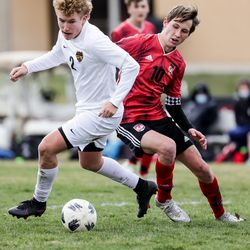Wasatch's Jack Jarret controls the ball ahead of Springville's Tyson Peterson during a boys soccer game in Springville on Tuesday, March 23, 2021.