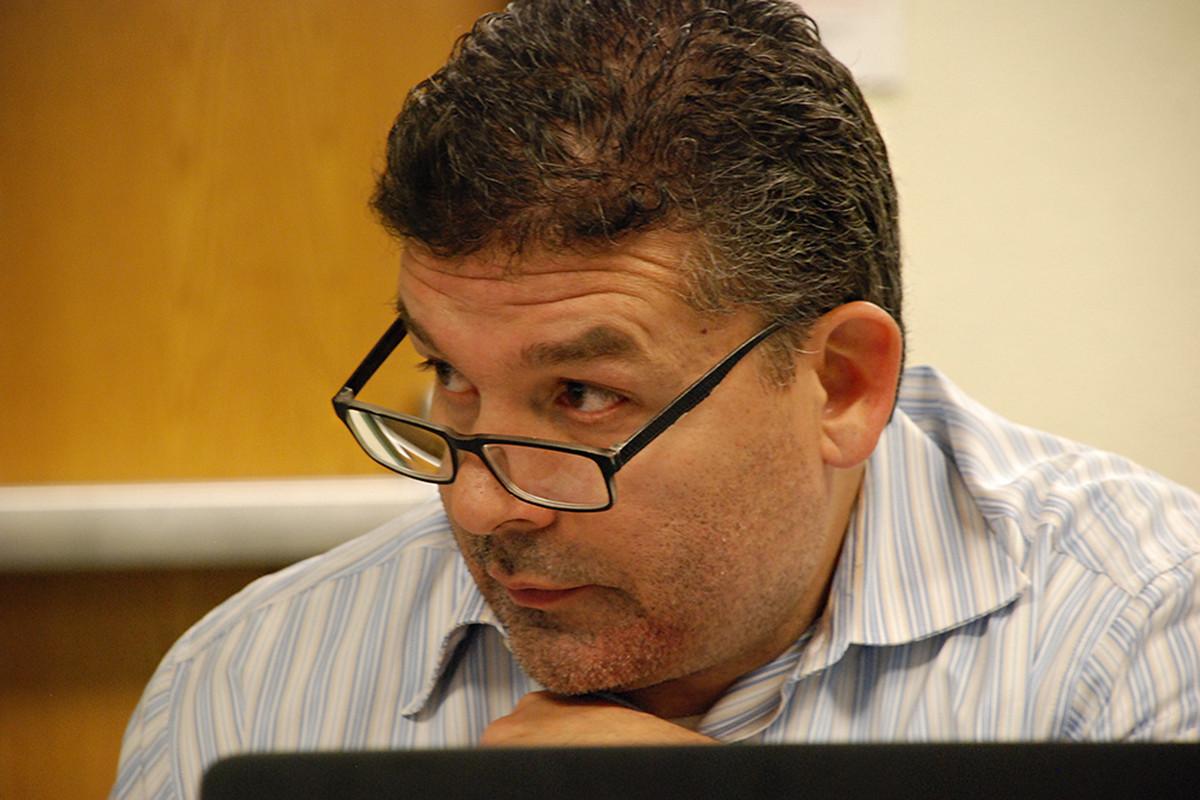 Aurora Central High School's interim principal Gerardo De La Garza at a meeting in February.