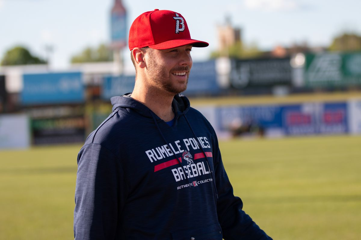 Mets pitching prospect Tyler Megill smiles before a game on May 13, 2021.