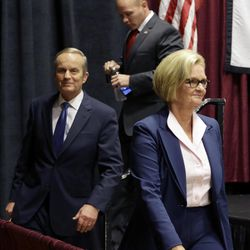 Democratic Sen. Claire McCaskill, right, walks off the stage with challengers Republican Todd Akin, left, and Libertarian Jonathan Dine following their debate in the Missouri Senate race Friday, Sept. 21, 2012, in Columbia, Mo.