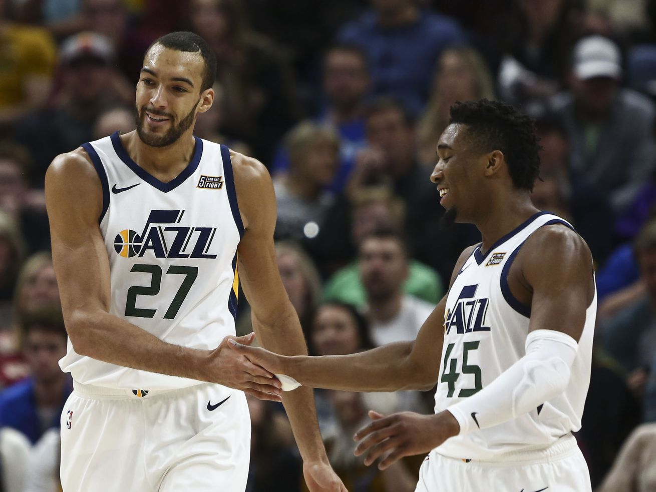 Utah Jazz center Rudy Gobert, left, and Jazz guard Donovan Mitchell during victory over Cleveland at Vivint Arena in Salt Lake City on Friday, Jan. 18, 2019.