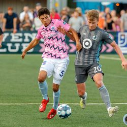 June 25, 2019 - Madison, Wisconsin, United States - Minnesota United midfielder Rasmus Schüller (20) fights for the ball during a friendly match against Forward Madison FC at Breese Stevens Field.