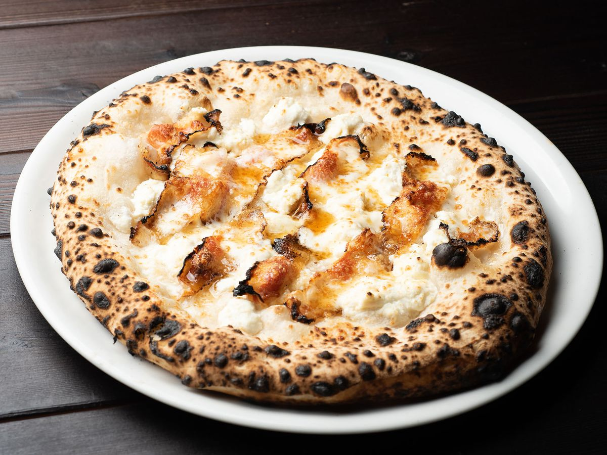 Sweet cheeks pizza with guanciale, ricotta forte, and cacio e pepe honey