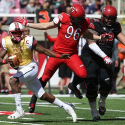 Utah's Troy Williams looks to pass as Nick Heninger (96) runs in during the annual Red & White Spring Game at Rice-Eccles Stadium in Salt Lake City on Saturday, April 15, 2017.
