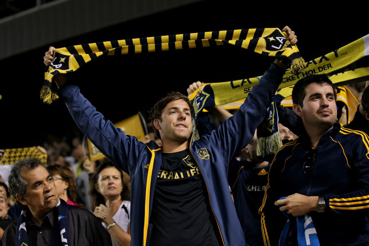 CARSON, CA - JULY 20:   A Los Angeles Galaxy fan cheers in the game with the Columbus Crew at The Home Depot Center on July 20, 2011 in Carson, California.  The Galaxy won 1-0.  (Photo by Stephen Dunn/Getty Images)