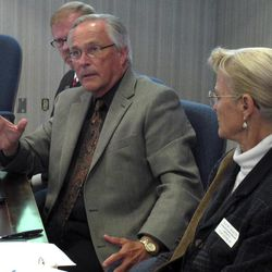 Kansas State Board of Education member Ken Willard, center, of Hutchinson, discusses public school students' performance on standardized reading and math tests, Tuesday, Sept. 18, 2012, in Topeka, Kan. Listening to his comments are fellow Republican board members John Bacon, left, of Olathe, and Kathy Martin, right, of Clay Center.