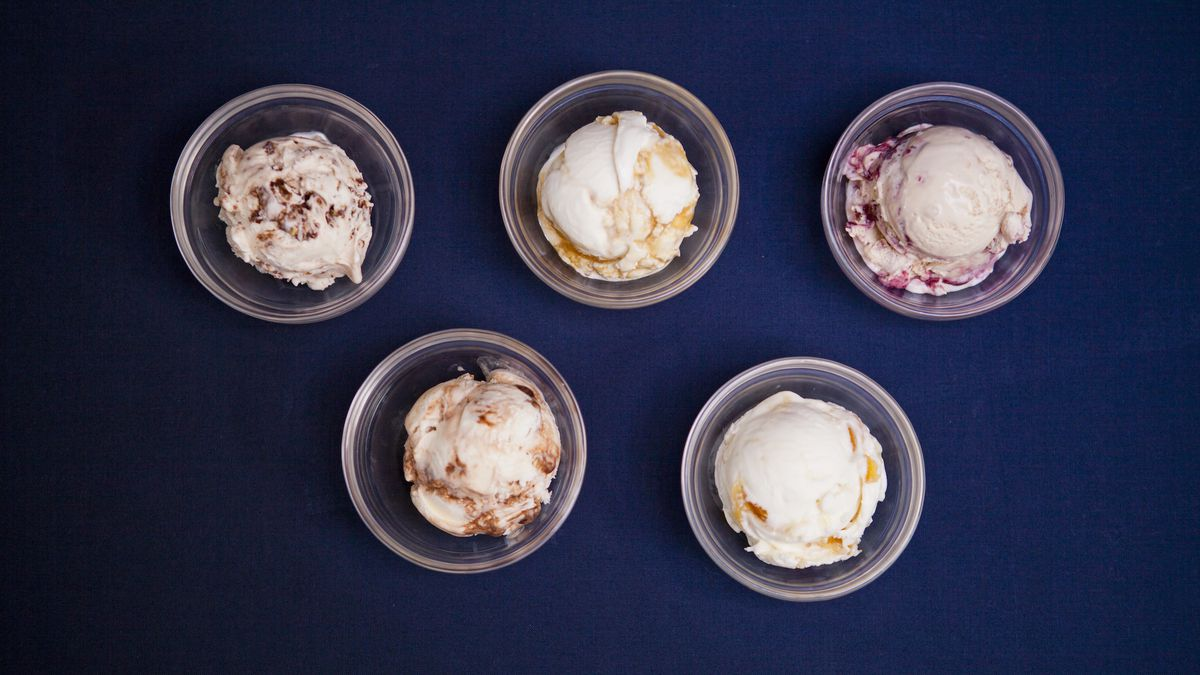Top-down view of five bowls of ice cream on blue background.