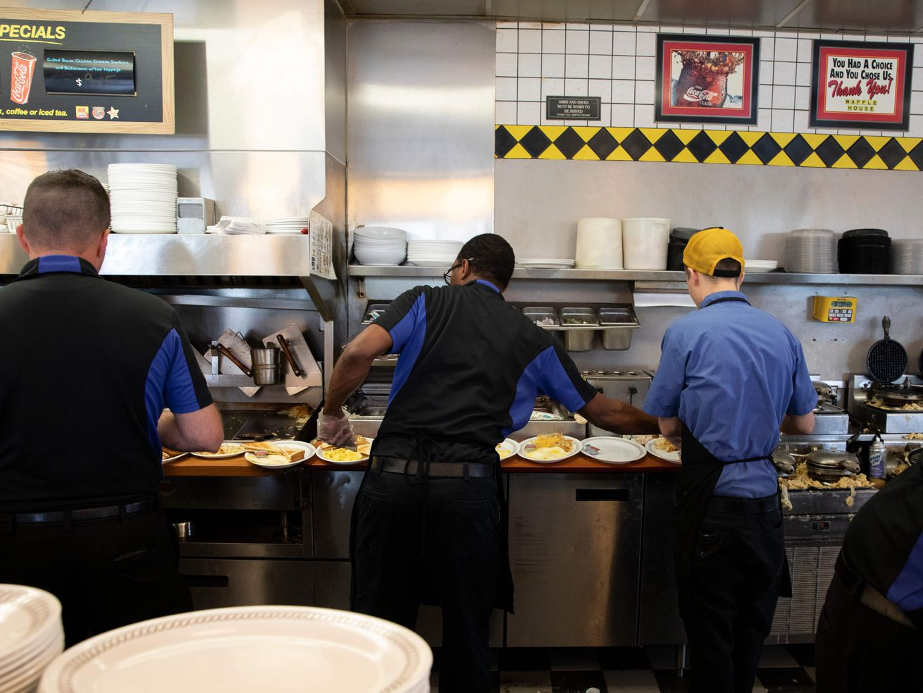Waffle House cooks in Conway, South Carolina, are hard at work the day before Hurricane Florence hits the coast.