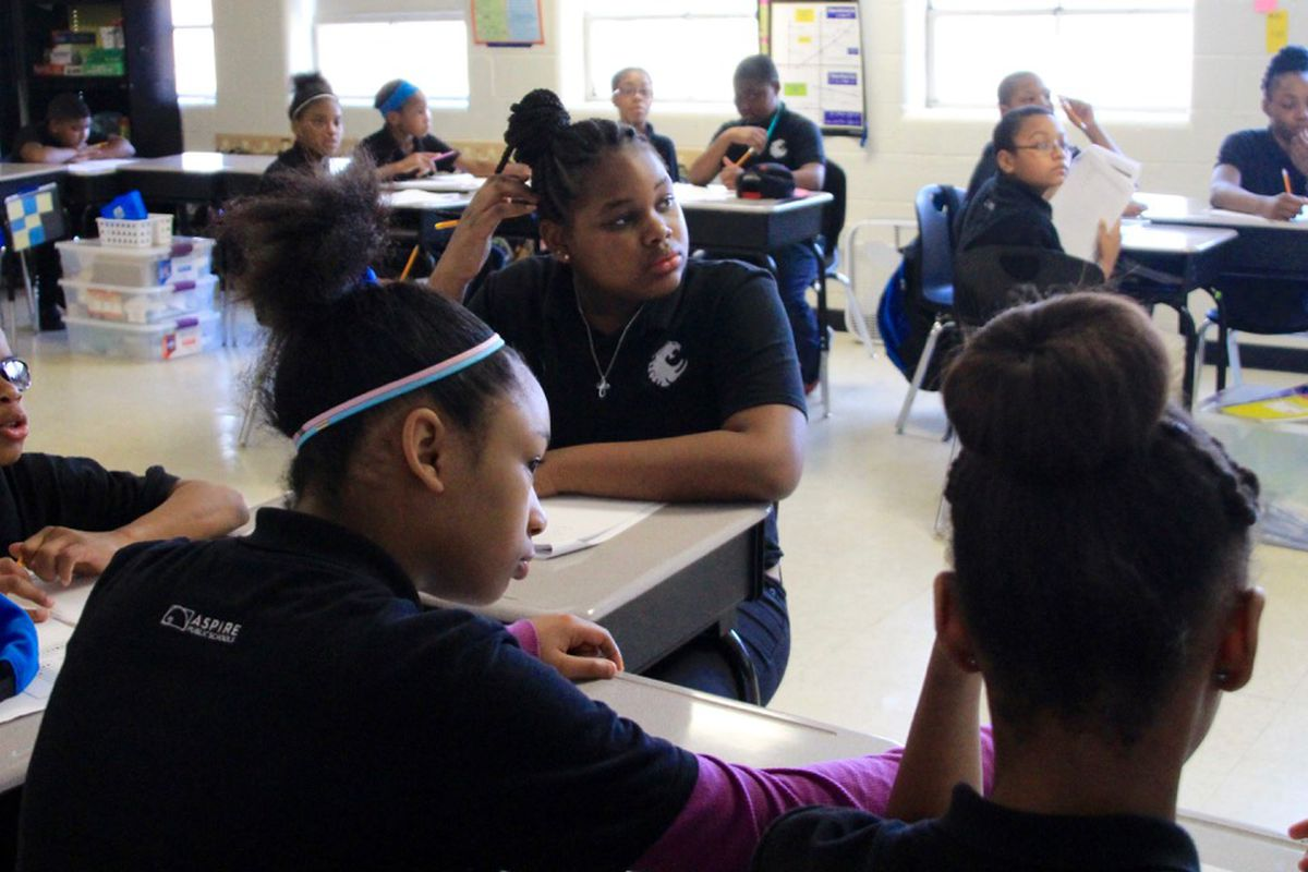 Students at Aspire Coleman listen during a sixth-grade math class. The Memphis charter school has changed its disciplinary practices in recent years to be more informed about the effects of emotional trauma, especially among female black students.