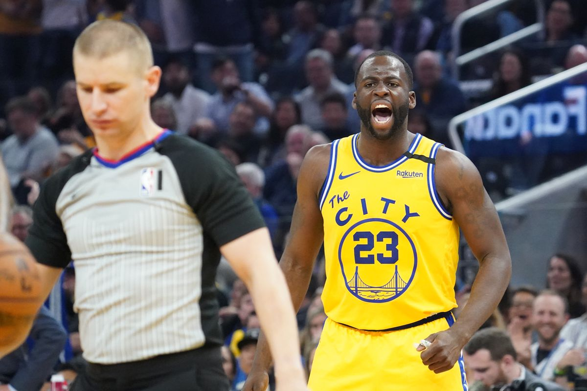 Golden State Warriors forward Draymond Green argues after being ejected by NBA official Tyler Ford against the Los Angeles Lakers during the second quarter at Chase Center.
