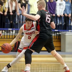 Manti's Kevin Clark dribbles around Grantsville's Davin Ekins during the 3A boys basketball state tournament quarterfinals at the Lifetime Activities Center in Taylorsville on Thursday, Feb. 20, 2020. Manti won 67-54.