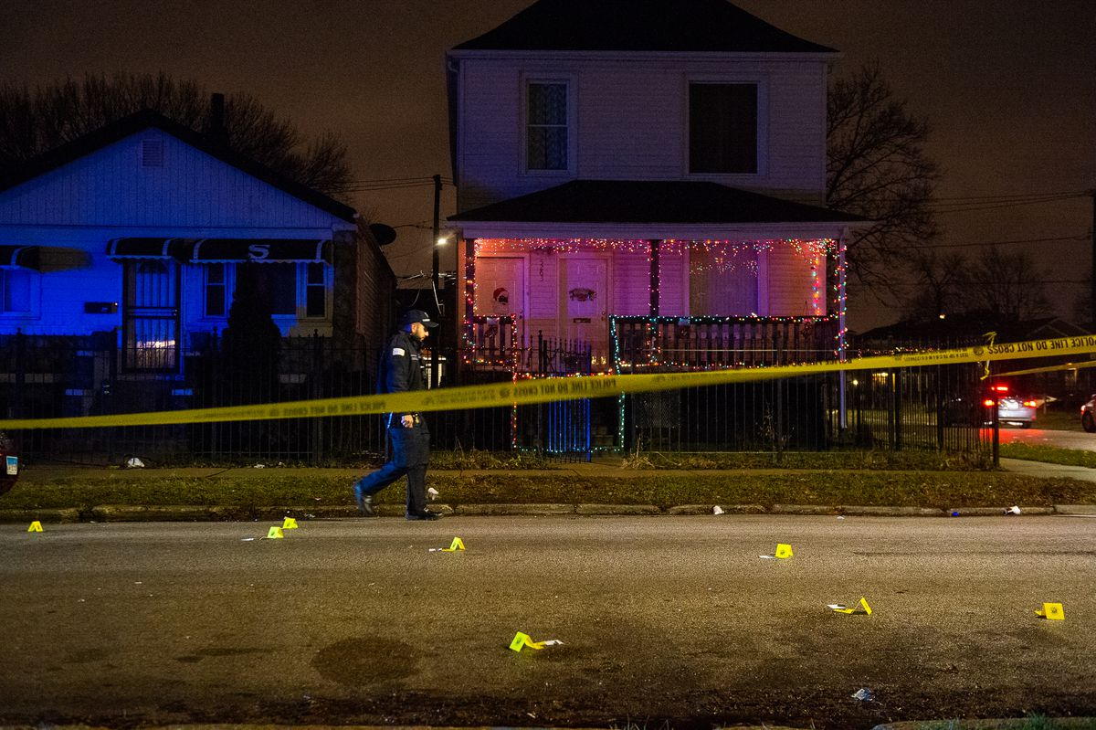 A Chicago Police officer walks through a crime scene where two women were shot, Monday night in the 5400 block of West Gladys. This marks the final shooting of 2018 in Chicago. | Tyler LaRiviere/Sun-Times