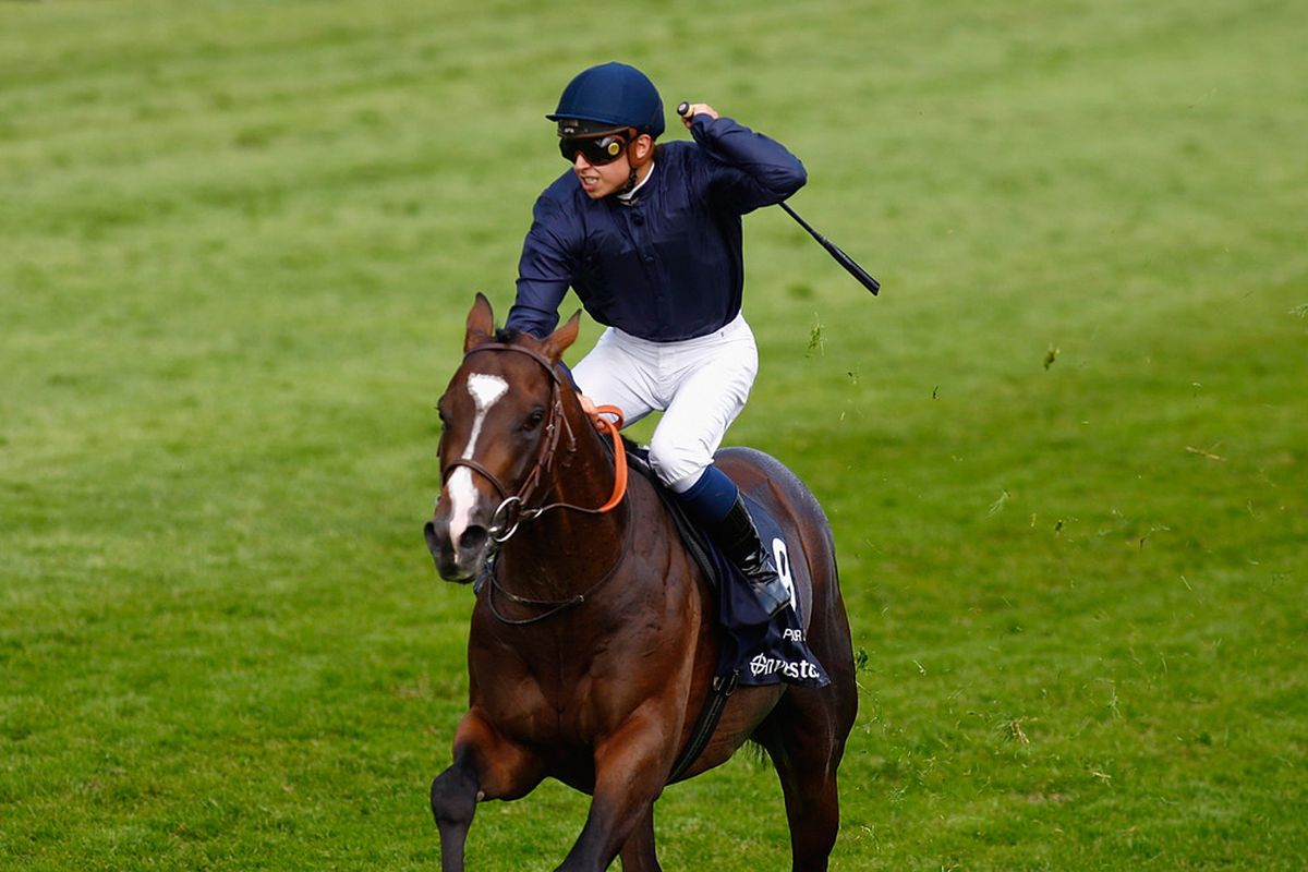 Pour Moi winning The Investec Derby at Epsom Racecourse.