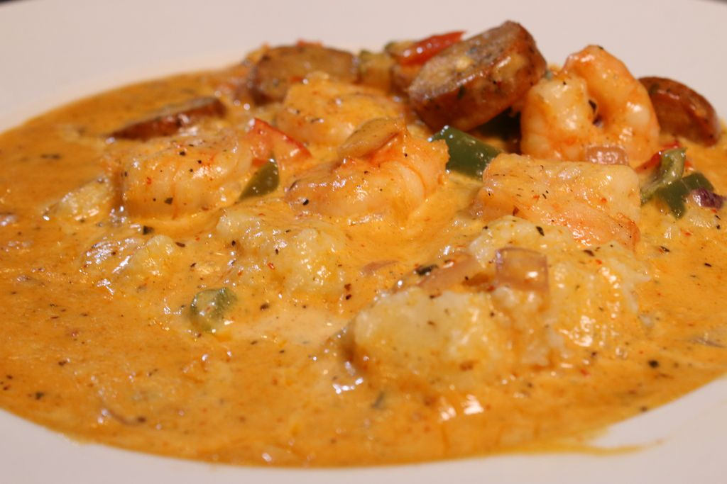 The shrimp and grits, served at Hidden Manna Cafe, is made with creamy grits topped with red and green pepper, garlic, onion in our home made shrimp and spicy chicken andouille sausage sauce.